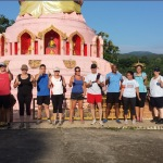 boot campers in front of the pink temple