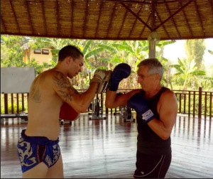 Tony our Australian bootcamp particpantdoing a Muay Thai session with Alexis